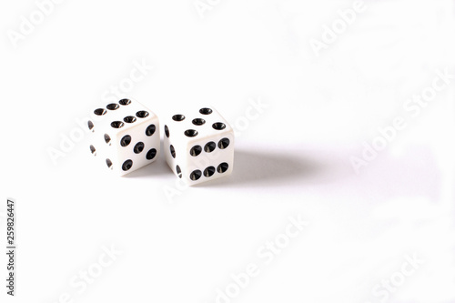 Photo  Seven and Eleven displayed on set of white dice against white BG