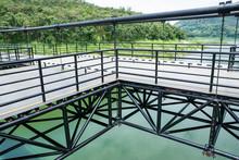The Corner Metal Suspension Bridge At Mae Kuang Udom Thara Dam Background In Chiang Mai,Thailand