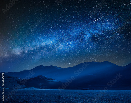 Tuinposter Nachtblauw Milky way over Castelluccio at night, Umbria, Italy