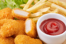 Chicken Nuggets, French Fries And Chili Sauce
