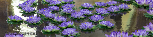 Tuinposter Waterlelies lotus,purple artificial flowers are floating on the water