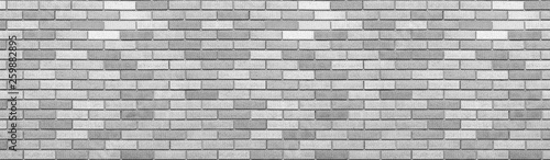 Abstract gray brick wall texture background. Horizontal panoramic view of masonry brick wall.