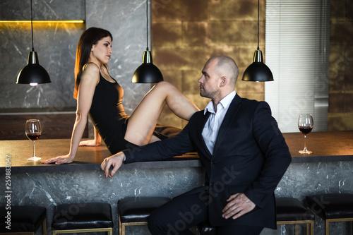 Fényképezés  A girl and a man in a restaurant
