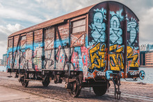 The Carriage Painted With Different Graffiti Next To The River In Copenhagen, Denmark . March 3, 2019