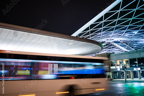 Fotografía  Tilburg, Noord Brabant, Netherlands - april 2 2019: A bus driving next to the bus station and train station