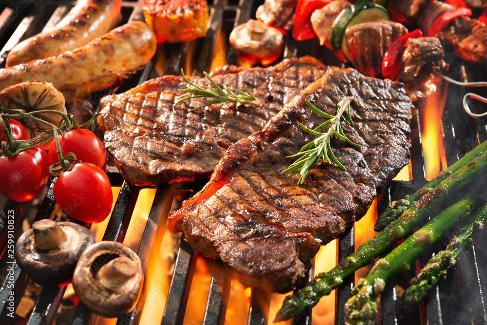 Fototapety, obrazy: Delicious grilled meat with vegetables sizzling over the coals on barbecue