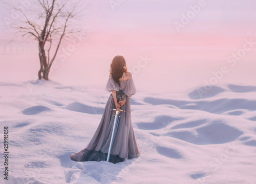 Stampa su Tela mysterious lady from Middle Ages with dark hair in gentle gray blue dress in sno