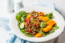 Vegan Salad With Lentils, Pumpkin And Dried Tomatoes In White Plate.