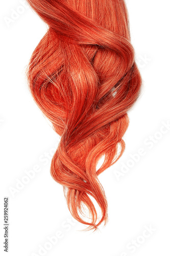 Fotografia Long wavy red hair isolated on white background