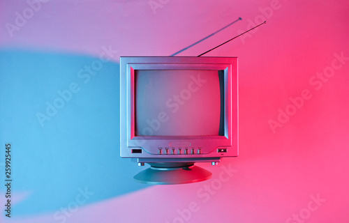 canvas print motiv - splitov27 : Retro wave, 80s. Old tv with antenna with neon light. Top view, minimalism