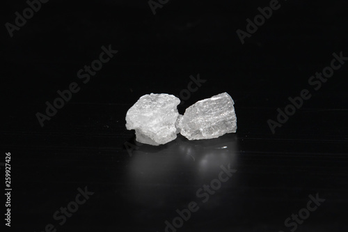 Photo  Crystal methamphetamine on a black background
