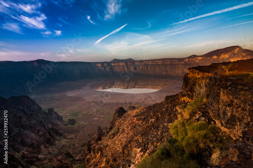 Fotografie, Obraz A stunning view of the Al Wahbah crater on a sunny day, Saudi Arabia