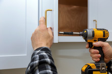 The Installing A Furniture Handle Process Of Assembling Cabinet