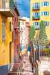 Nice in France, small street with typical colorful facade in the old town