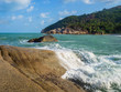 The waves beat on the rocks of the coast of Koh Pangan. Thailand