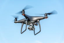 Drone In The Sky. Unmanned Aerial Vehicle Flying In The Air.