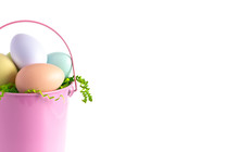 Easter Basket Filled With Decorated Eggs Isolated On A White Background