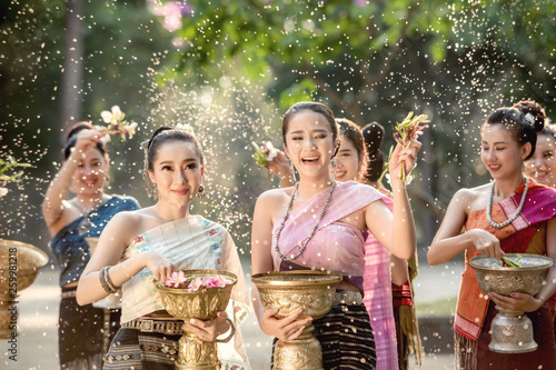 Vientiane Laos APRIL 4 2019 : Young happy beauty Asian woman splashing water during  Water Songkran festival ,Thailand Laos traditional Tableau sur Toile