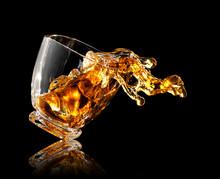 Splash Of Whiskey In Glass