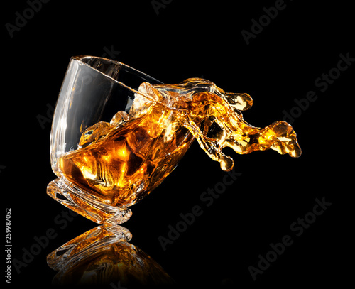 Canvas Prints Alcohol splash of whiskey in glass