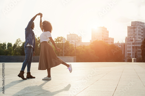 plakat Loving couple dancing at sunset on the street