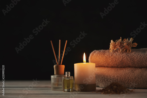 Obraz Towels, candle and massage oil on white table - fototapety do salonu