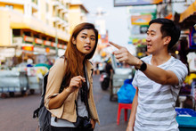 Young Female Tourist Asking Fo...