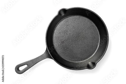 Cuadros en Lienzo Black iron pan isolated on white background.