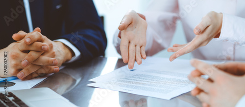 Photographie Group of business people and lawyers discussing contract papers
