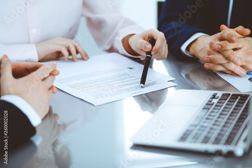 Photo  Group of business people and lawyers discussing contract papers