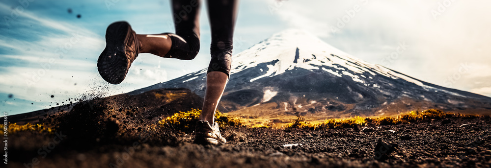 Fototapety, obrazy: Legs of the woman running on the trail with volcano on the background