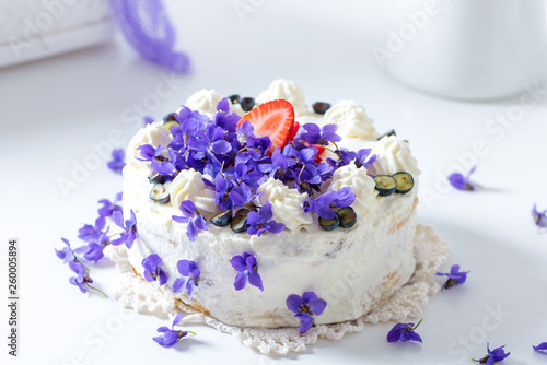 Delicious home-baked cream cake decorated with fresh violets (baked by Alina Tsc Canvas Print
