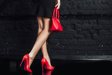 Photo Of Sexy, Women's Legs In Red Shoes On A Black  Background. Lifestyle!