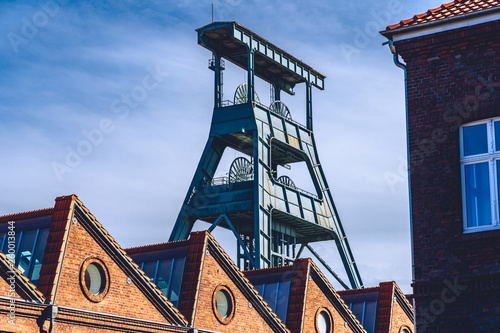Fototapeta Old mine tower with destroyed building of zeche ewald recklinghausen germany
