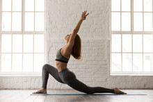 Sporty Woman Practicing Yoga, ...
