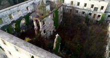 Dynamic Drone Aerial View Of A Castle Ruined During WW2 By Resistance Fighters, Since It Housed German Troops.