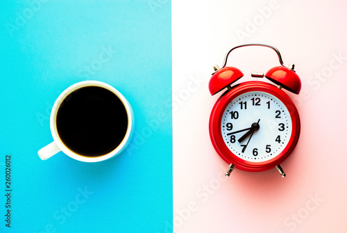 Recess Fitting Cafe Red alarm clock and a cup of coffee. Morning concept. Minimal composition.