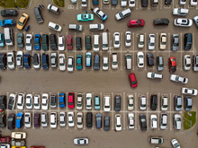 A View From Above To The Lines Of Parked Cars. Heavy Traffic In The Parking Lot. Searching For Spaces In The Busy Car Park. Cruising For Parking In Dormitory Area. Difficulties Of Parking In The City