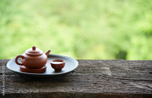Foto  Chinese tea set oriental drink style on Natural green backdrop