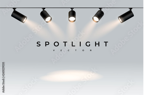 Fotobehang Licht, schaduw Five modern black spotlights shine in one direction realistic transparent background for show contest or interview.Illuminated effect form projector, projector for studio.