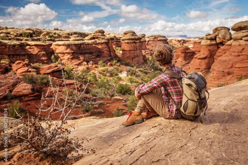 Fotografie, Obraz  Hiker in Canyonlands National park, needles in the sky, in Utah, USA