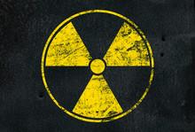 Yellow Radioactive Sign Over Black Background