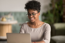 Happy African American Woman Using Laptop Work Study In Office