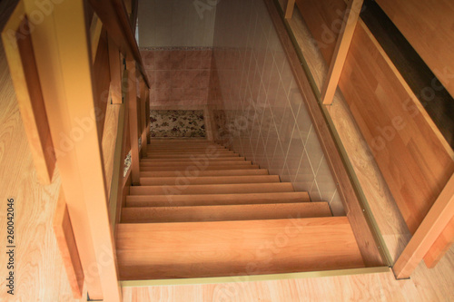 Photo Stands Stairs Top view of a new wooden staircase with railing lit by a window
