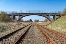 Old Viaduct Over The Railway Tracks. Concrete Bridge Over The Railroad.
