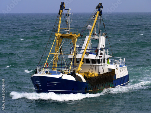 Fényképezés  Fishing boat in choppy sea underway to harbour to discharge fish.