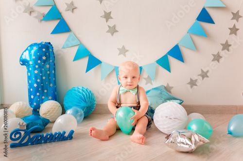 Adorable Baby Boy Celebrating His First Birthday Smash Cake