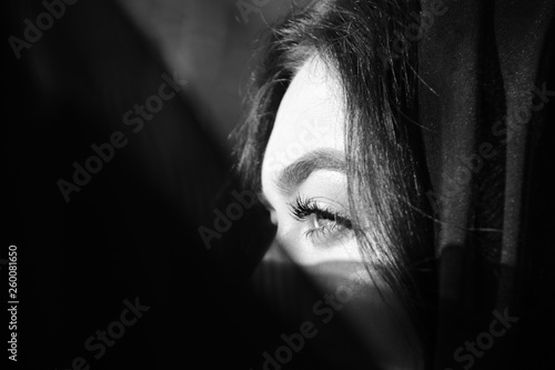 Beautiful woman in black till, black and white photography
