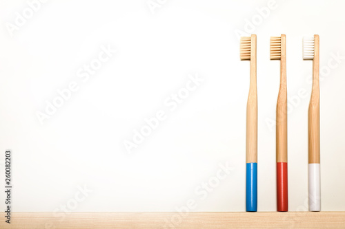Stickers pour porte Pierre, Sable full colours bamboo toothbrushes on white background. Place for text. Ecoproduct. eco-friendly.