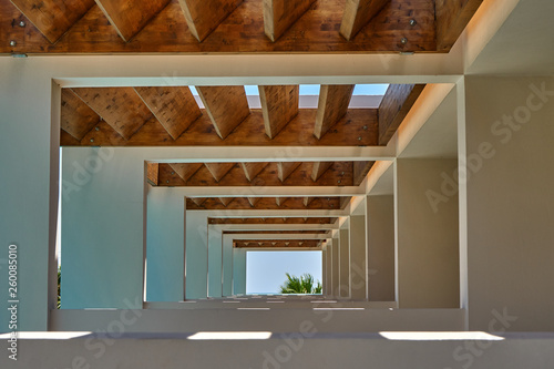 Contemporary corridor of tropical resort terrace under wooden beams Fototapeta